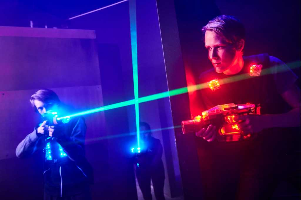 Two people playing lasergame